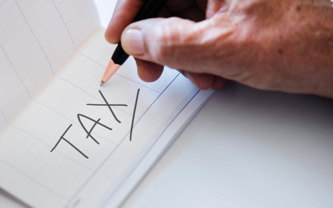 https://f.hubspotusercontent40.net/hubfs/8646946/BCA_New_website_2020/Blog/Banner/Person-writing-Tax-on-paper-1080x675.jpg